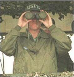 Clinton With Capped Binoculars